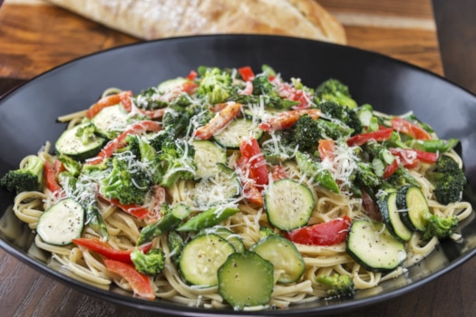 Bowl of Pasta Primavera with Italian bread