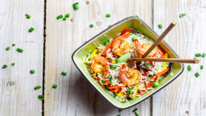 Mix vegetables with rice and shrimp